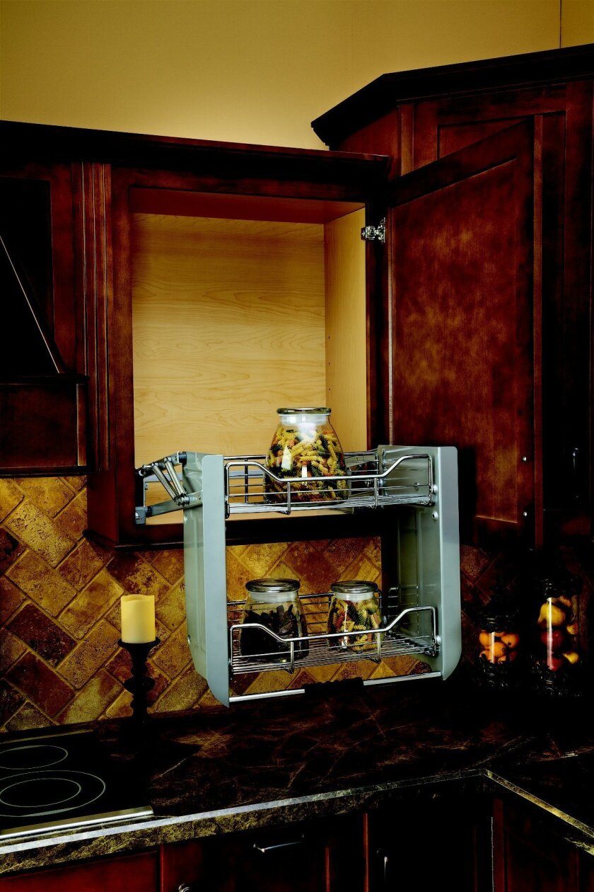 Pull-down interior cabinet accessories can make accessing hard-to-reach items easier for aging homeowners.