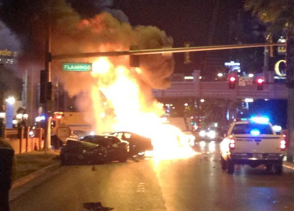 Smoke and flames billow from a burning vehicle after a shooting and multicar accident on the Las Vegas Strip early Thursday.
