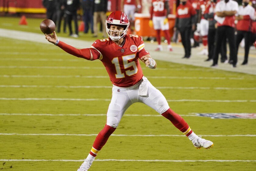 Kansas City Chiefs quarterback Patrick Mahomes passes against the Houston Texans in the first half of an NFL football game Thursday, Sept. 10, 2020, in Kansas City, Mo. (AP Photo/Charlie Riedel)