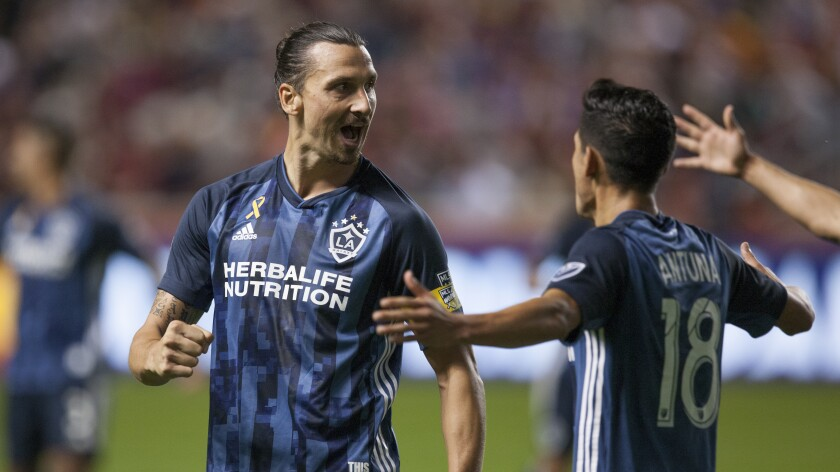 Galaxy star Zlatan Ibrahimovic, left, celebrates with teammate Uriel Antuna after scoring against Real Salt Lake on Sept. 25.