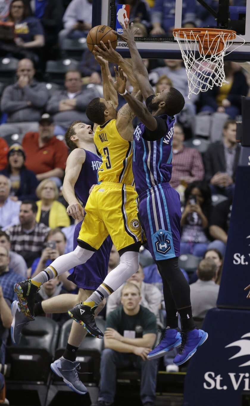 Indiana Pacers' George Hill (3) shoots against Charlotte Hornets' Cody Zeller (40) and Michael Kidd-Gilchrist (14) during the first half of an NBA basketball game Wednesday, Feb. 10, 2016, in Indianapolis. (AP Photo/Darron Cummings)