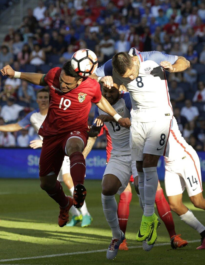 Bolivia forward Carmelo Algaranaz (19) and U.S. forward Clint Dempsey (8) go after a corner kick in the first half of an international friendly soccer match, Saturday, May 28, 2016, in Kansas City, Kan. (AP Photo/Colin E. Braley)