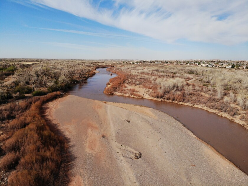 This April 13, 2021 image shows the Rio Grande flowing through Rio Rancho, New Mexico. The U.S. Bureau of Reclamation released its annual operating plan for the river Thursday, April 15, 2021, saying it's going to be a tough year due to below average snowpack and spring precipitation. (AP Photo/Susan Montoya Bryan)