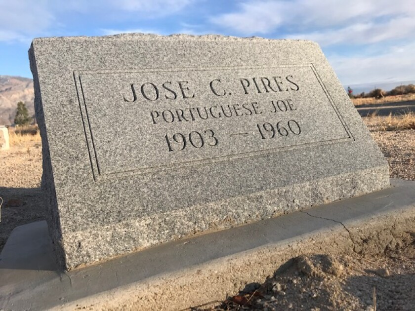 A modest granite headstone marks the grave site of Jose C. Pires at Mt. Whitney Cemetery in Lone Pine, Calif.