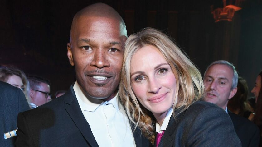 Jamie Foxx and Julia Roberts at the Sean Penn CORE gala at the Wiltern in Los Angeles.