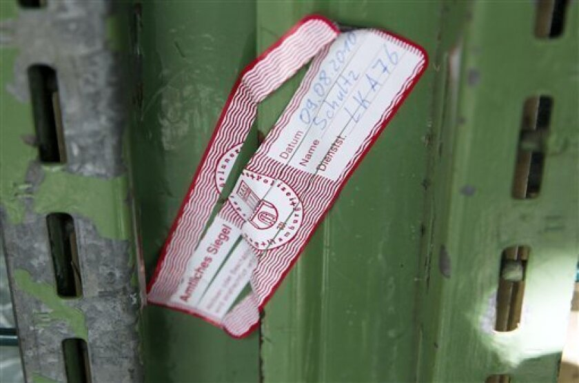 A police seal is pictured on the door of the former Al-Quds-mosque in Hamburg, northern Germany, on Monday, Aug 9, 2010.  The Hamburg mosque that was once frequented by some of the Sept. 11 attackers was closed Monday by German authorities, who said they believed it is now a meeting-point for Islam