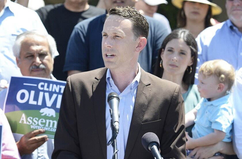 Fresno City council member Clint Olivier announces his candidacy for California's 31st Assembly District outside Sam's Italian Deli and Market last June. (Craig Kohlruss / Fresno Bee)