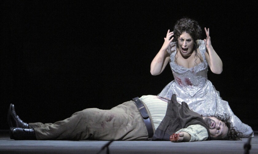 "Sondra Radvanovsky as Floria Tosca and Marco Berti as Mario Cavaradossi in ""Tosca"" at the Dorothy Chandler Pavilion."