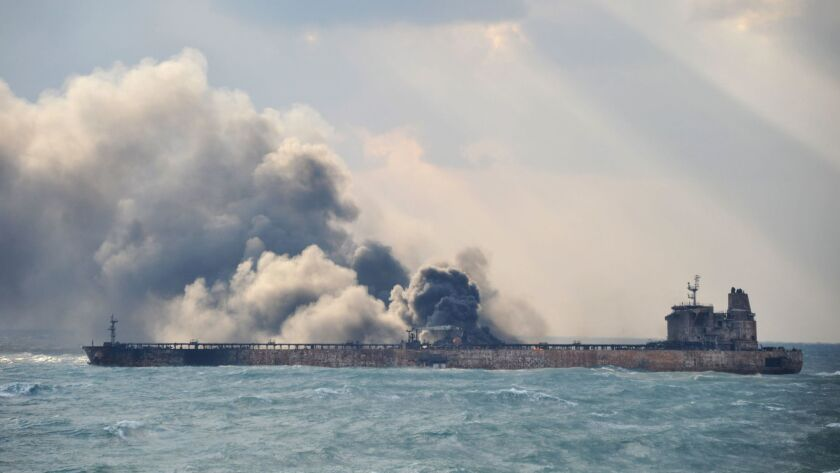 Smoke and flames spew from the burning Iranian oil tanker Sanchi off the coast of eastern China on Jan 9.