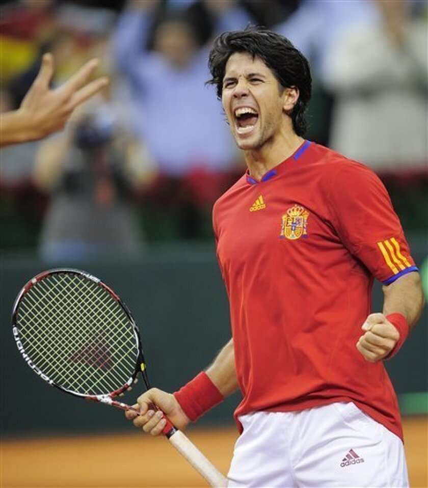Spain's Fernando Verdasco reacts after winning with his teammate Felicianio Lopez the Davis Cup tennis final during the doubles match against Radek Stepanek and Tomas Berdych of Czech Republic at the Sant Jordi stadium in Barcelona, Spain, on Saturday, Dec. 5, 2009. (AP Photo/Manu Fernandez)