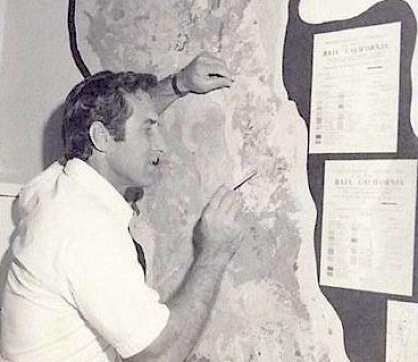 Gordon Gastil studies a map he made of Baja California. Image taken in 1976.