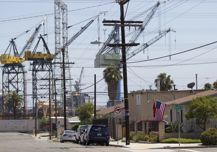 The clash between housing and industry that has defined the debate over Barrio Logan's future is seen here at the intersection of 27th Street and Boston Avenue.