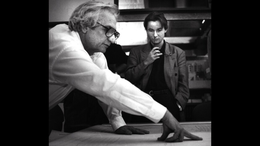 Esa-Pekka Salonen, right, looks at plans for Walt Disney Concert Hall with architect Frank Gehry in November 1990.