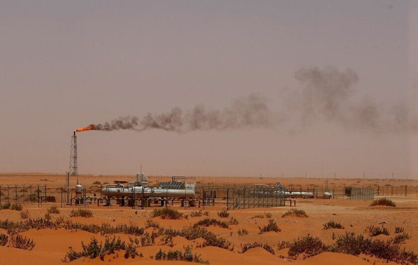 A flame from an oil pump in the Saudi desert is seen about 100 miles east of Riyadh. Oil is trading on the world market at about $50 per barrel.