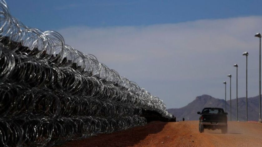 Rancher John Ladd drives along the border fence separating his ranch in Cochise County, Arizona, from Mexico on March 2.