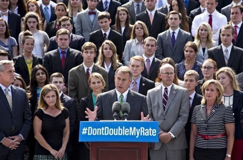 In this July 8, 2013, photo, with a backdrop of college students on the step of the House of Representatives, Speaker of the House John Boehner, R-Ohio, center, and GOP leaders talk about the politics of federal student loan rates which doubled on July 1, at the Capitol in Washington. Senate Democrats are trying to restore lower interest rates on student loans. A procedural vote is scheduled for Wednesday on a Senate measure that would return rates on subsidized Stafford loans to 3.4 percent for