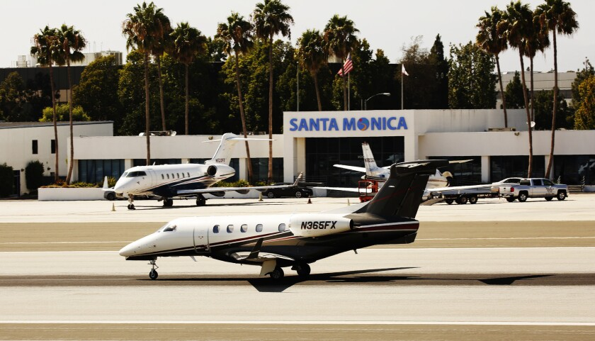 LOS ANGELES, CA AUGUST 31, 2016 -- Jet and small aircraft land and liftoff at Santa Monica Airport o