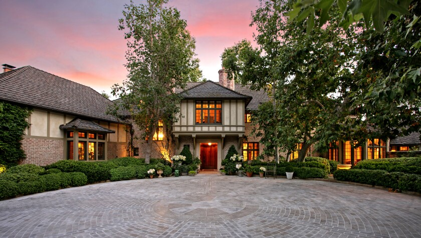 In Beverly Hills, an English-inspired estate boasts three acres of style. Asking price: $59.5 million. The amenity-loaded mansion, complete with a movie theater, wine cellar, tennis court and virtual golf, was designed by former White House decorator Michael Smith.