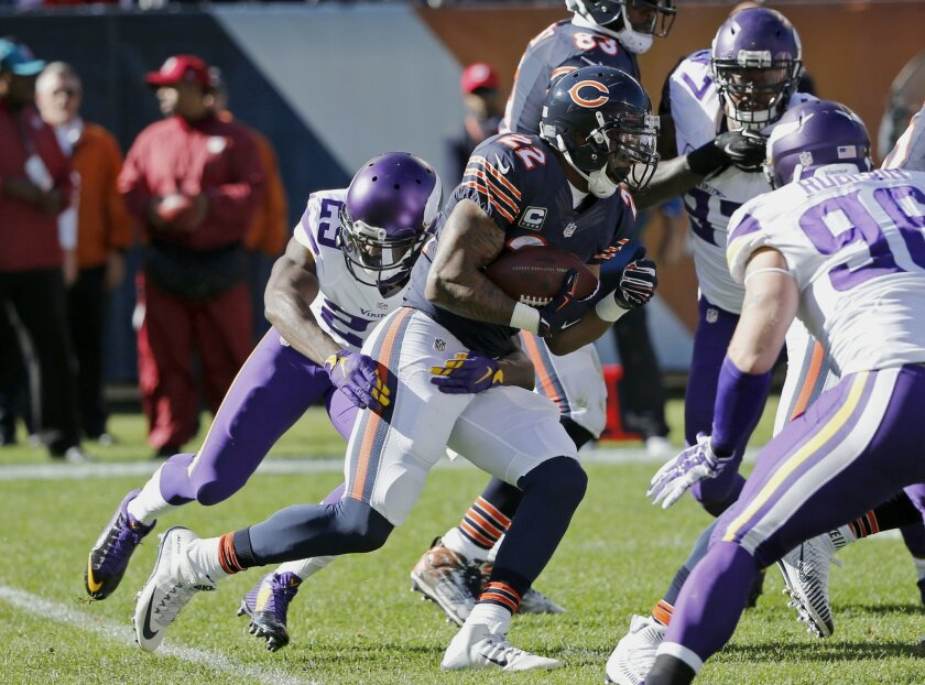 Chicago Bears running back Matt Forte (22) runs the ball against Minnesota Vikings cornerback Xavier Rhodes (29) during the first half of an NFL football game, Sunday, Nov. 1, 2015, in Chicago. (AP Photo/Charles Rex Arbogast)