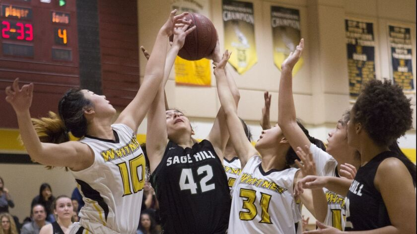 Sage Hill's Nadia Akbari rebounds the ball during an Academy League opening game against Whitney in