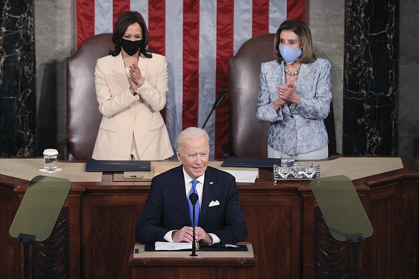 President Biden speaks in the House chamber. Behind him are Vice President Kamala Harris, left, and Speaker Nancy Pelosi.