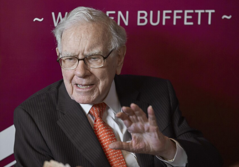 FILE - In this May 5, 2019, file photo Warren Buffett, Chairman and CEO of Berkshire Hathaway, speaks during a game of bridge following the annual Berkshire Hathaway shareholders meeting in Omaha, Neb. Berkshire Hathaway Inc. reports earnings on Saturday, Nov. 2. (AP Photo/Nati Harnik, File)