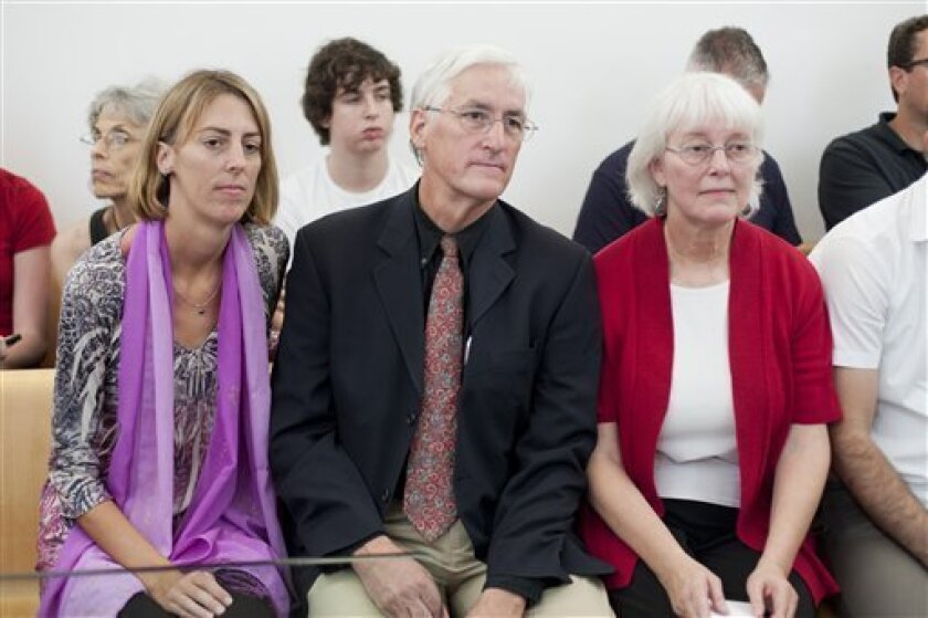 Cindy, right, and Craig Corrie, center, the parents of Rachel Corrie, sit together with their daughter Sarah, left, at the District Court in Haifa, northern Israel, Sunday, July 10, 2011. An Israeli court has heard its final witness in a trial surrounding the death of American activist Rachel Corrie, who was crushed by an Israeli military bulldozer in the Gaza Strip in 2003. (AP Photo/Dan Balilty)
