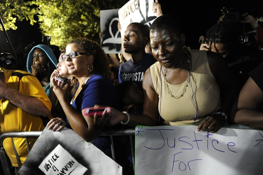 Demonstrators react to the not guilty verdict in the trial of George Zimmerman at the Seminole County Courthouse in Sanford, Fla.