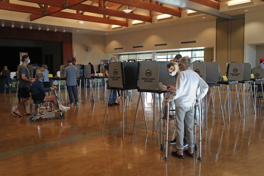 Voters make their ballot selections on Election Day 2020 at OASIS Senior Center in Newport Beach.