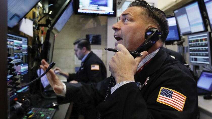 Trader Jonathan Mueller works in a booth on the floor of the New York Stock Exchange on Dec. 7.