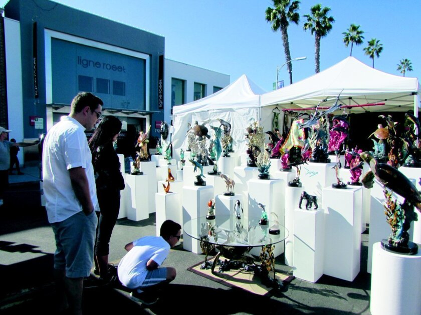 A family is intrigued by the marine-animals created from glass during the 2014 La Jolla Art and Wine Festival. Light File