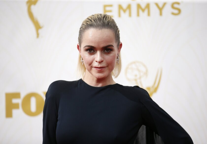 Taryn Manning is among the celebrities who beat the heat with slicked-back hair as she arrives at the 67th Primetime Emmy Awards on Sunday.