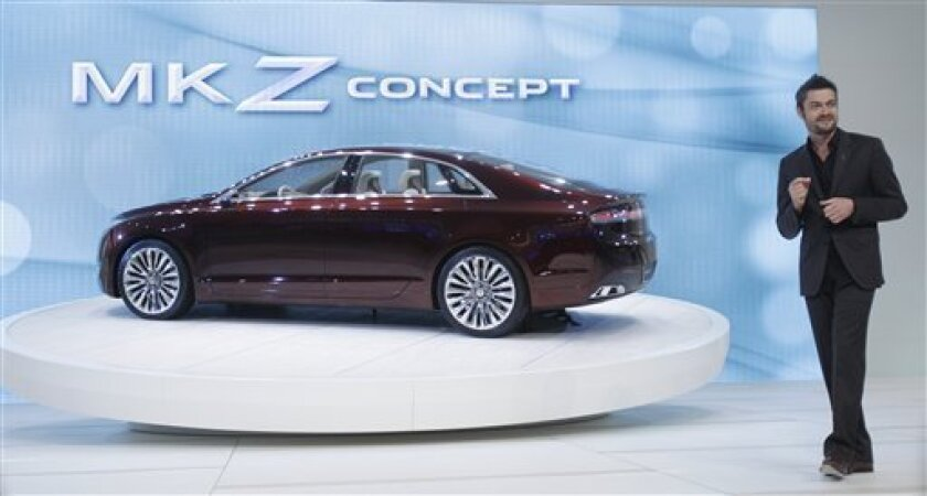 Max Wolff, director of Lincoln Design introduces the Lincoln MKZ concept during the North American International Auto Show in Detroit, Tuesday, Jan. 10, 2012. (AP Photo/Carlos Osorio)