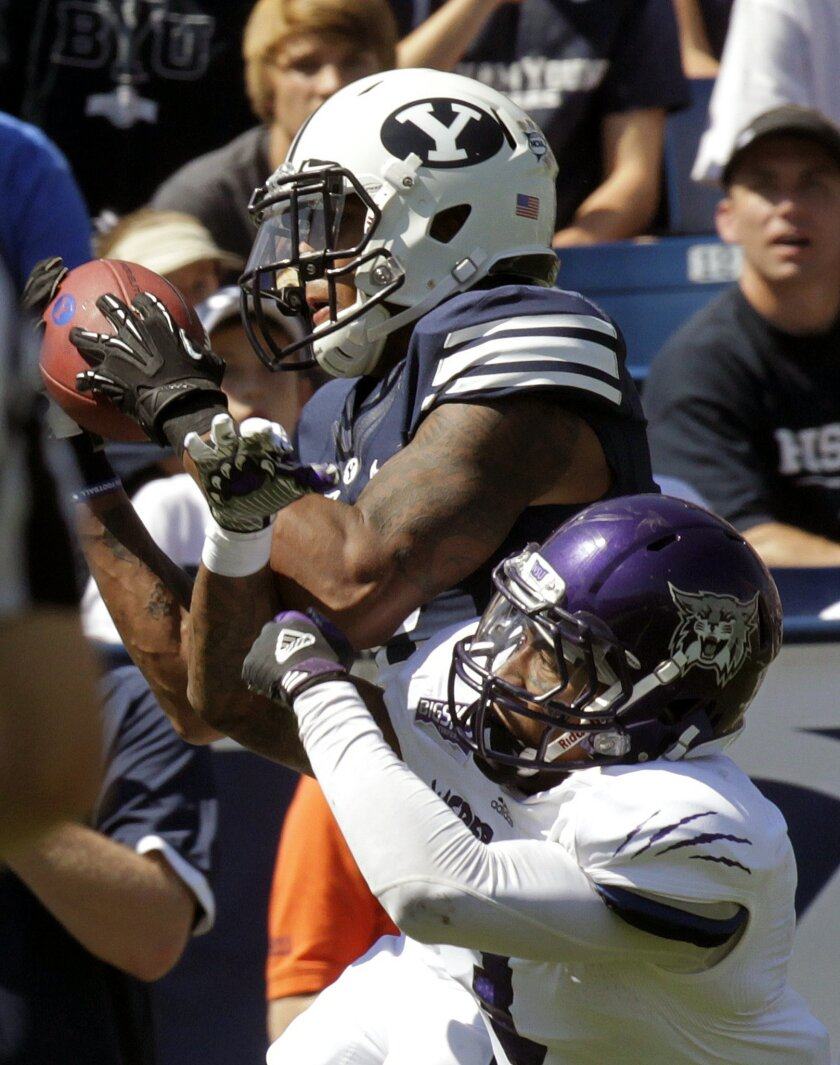 FILE - In this Sept. 8, 2012, file photo, Brigham Young wide receiver Cody Hoffman, top, catches a touchdown pass as then-Weber State cornerback Devin Pugh defends in the first quarter of an NCAA college football game, in Provo, Utah. Former Weber State college football player Devin Pugh, who says