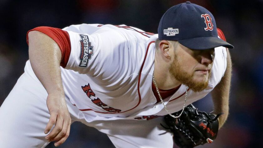 9a0baf656 Boston Red Sox relief pitcher Craig Kimbrel looks for the catcher s sign in  Game 3 of baseball s American League Division Series against the Cleveland  ...