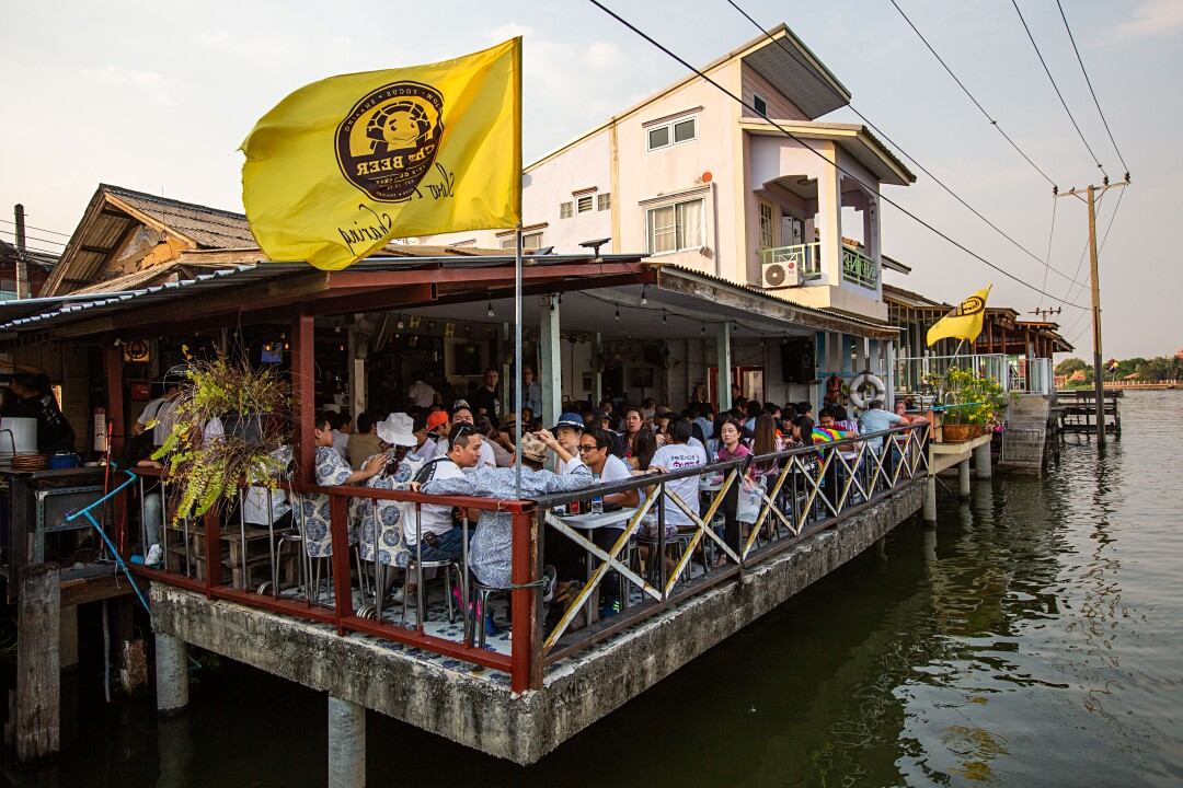 View of Chit Beer, a craft brewery on Koh Kret island on the Chao Phraya River in Bangkok, Thailand.