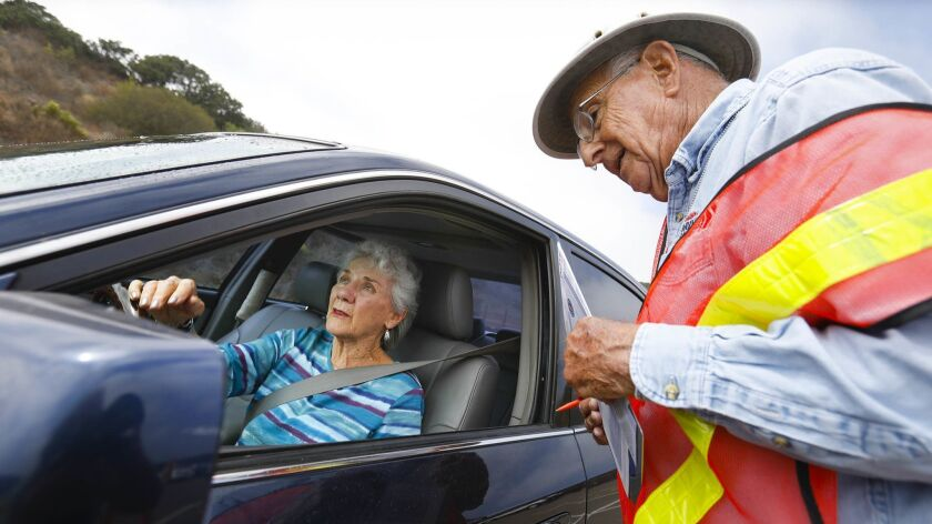 Susan O'Connor, 85, of Carlsbad has her car safety-checked by Bob Vatz ,an AARP CarFit event coordinator on Wednesday. About 20 residents of the La Costa Glen retirement community took part in the event, which was part of a driver-safety program led by resident Les Besser.