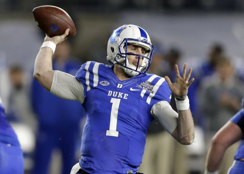 FILE - In this Dec. 26, 2015, file photo, Duke quarterback Thomas Sirk looks to throw during the first half of the Pinstripe Bowl NCAA college football game against Indiana at Yankee Stadium in New York. Sirk has already come back from one ruptured Achilles tendon. Now he's doing it again _ and fas