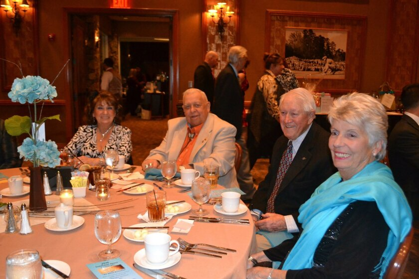 Sitting at dinner together are from left, Sandy and Charlie Teichert, and Chuck and Betty LeMenager.