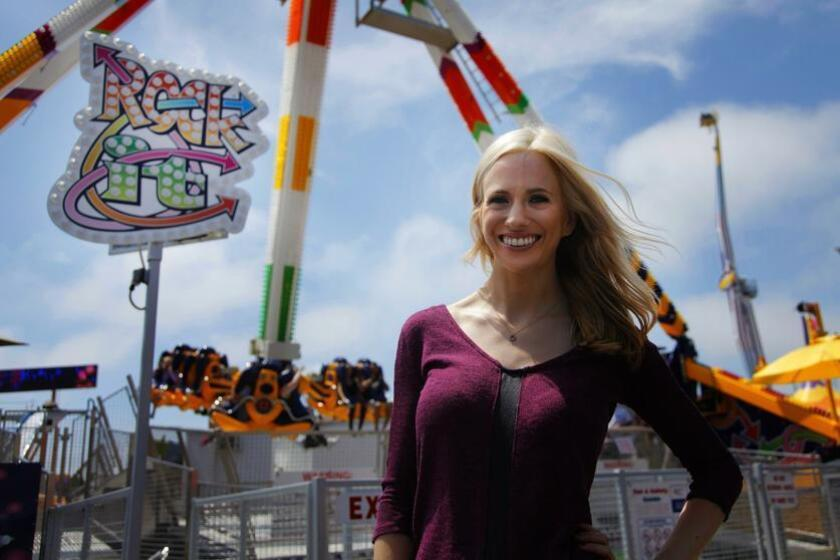 Michelle Dederko rides the Rock It ride at the San Diego County Fair. Photo by Adrian Carmona