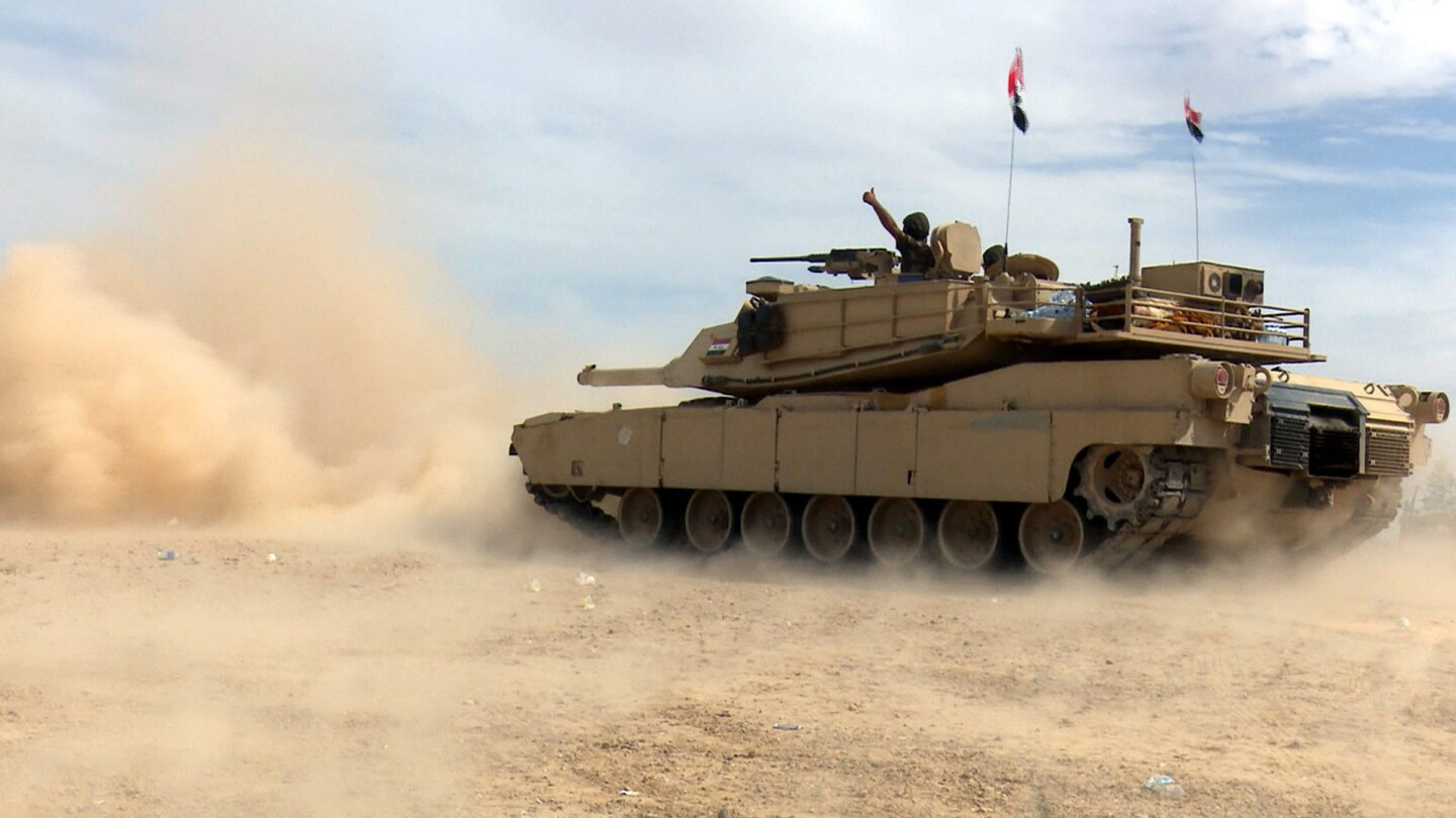 An Iraqi army tank advances in Tikrit on Tuesday during fighting with Islamic State militants.