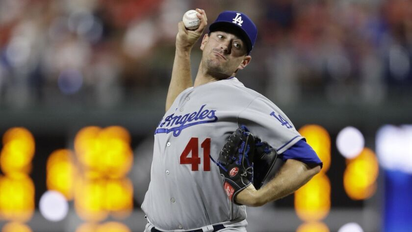 Los Angeles Dodgers' Daniel Hudson in action during a baseball game against the Philadelphia Phillie