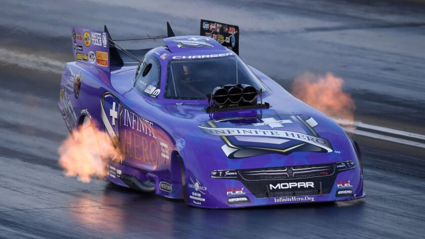 In this photo submitted by the NHRA, Jack Beckman races to the Funny Car preliminary top qualifying