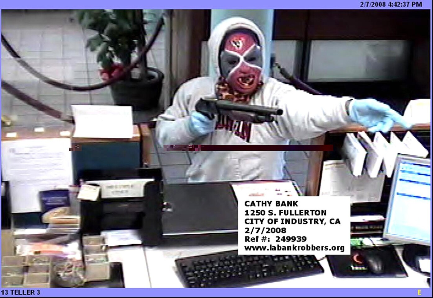 A surveillance photo of one of the WWF Shotgun Bandits during a robbery in the city of Industry in February 2008.
