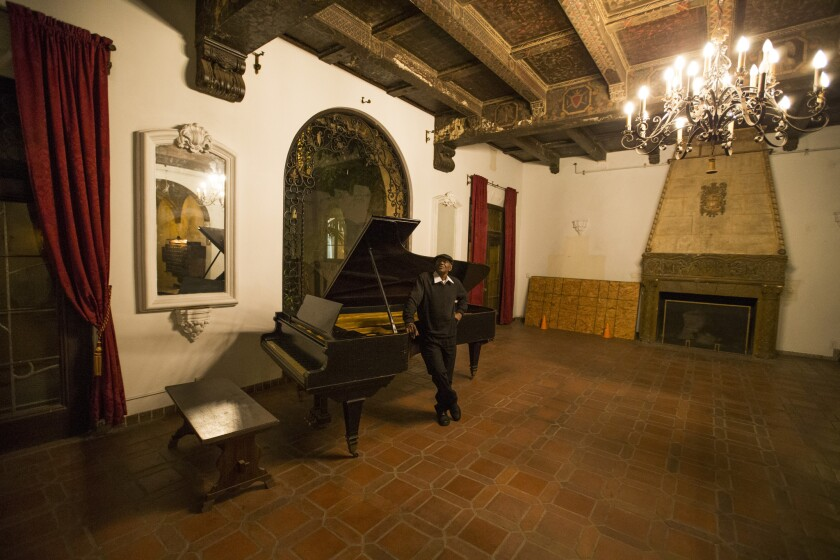 Fuller's grand piano is virtually all that's left in a public space of the apartment building.