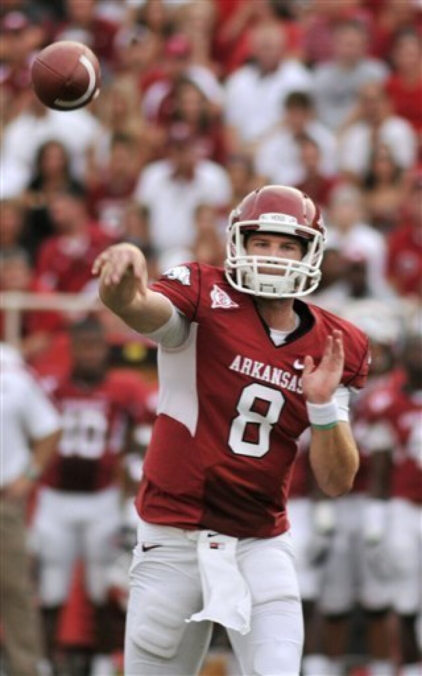 Arkansas quarterback Tyler Wilson (8) passes during the first half of an NCAA college football game with Missouri State in Fayetteville, Ark., Saturday, Sept. 3, 2011. (AP Photo/April L Brown)