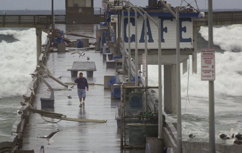 Powerful storms often pound the coast of California during El Nino years. In December 2002, huge waves battered the Ocean Beach pier and damaged the cafe operated by Chuck Fisher (pictured).