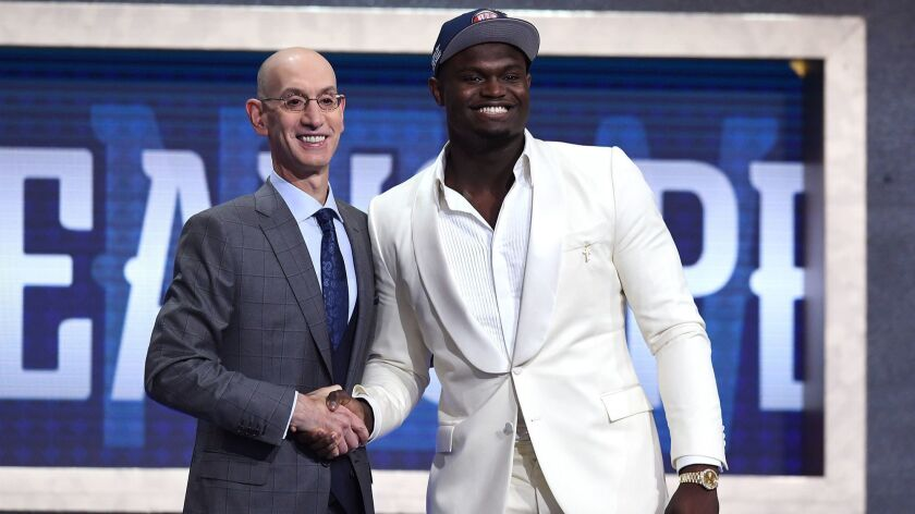 Zion Williamson poses with NBA commissioner Adam Silver after being drafted as the first overall pick by the New Orleans Pelicans during the NBA draft in New York on Thursday.