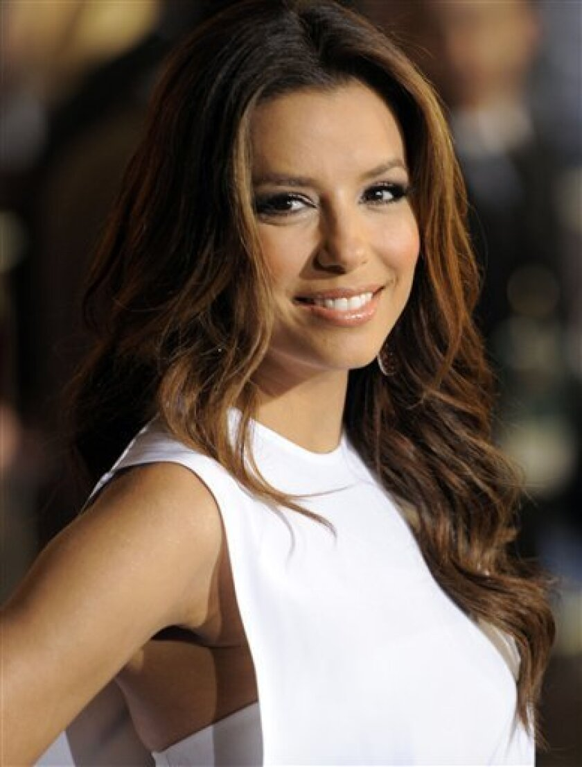 "FILE - In this May 7, 2011 file photo, actress Eva Longoria arrives at the World Premiere of ""Pirates of the Caribbean: On Stranger Tides"" at Disneyland in Anaheim, Calif. A Las Vegas nightclub owned by ""Desperate Housewives"" co-star Eva Longoria is temporary closing its doors amid financial troubles. Longoria's Beso club within the CityCenter complex on the Las Vegas Strip closed Monday, July 11, to save money. (AP Photo/Chris Pizzello, file)"