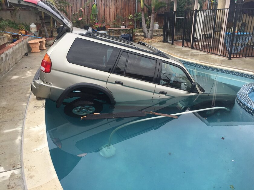 The driver of an SUV suffered minor injuries when she skidded on wet roads and landed in a backyard swimming pool of a home on Broadview Street in Spring Valley.
